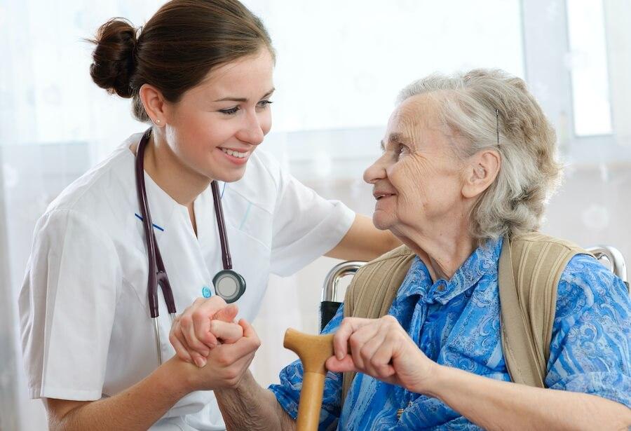 nurse talking to older woman