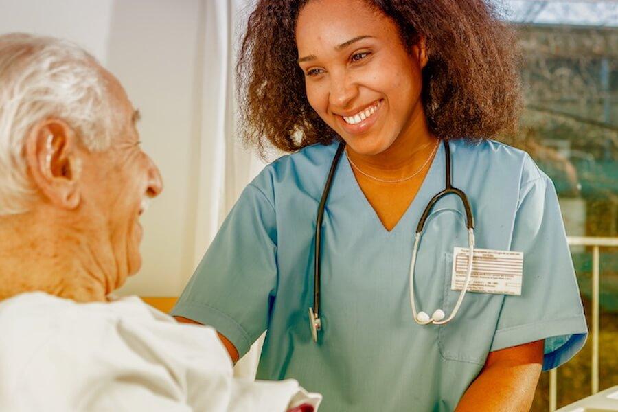 nurse talking to older man (1)