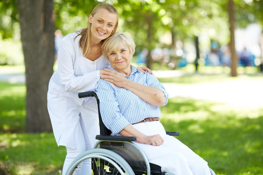 nurse with older lady in wheelchair