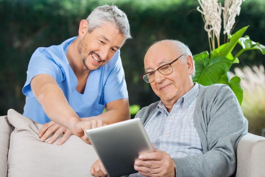 nurse with older man on tablet