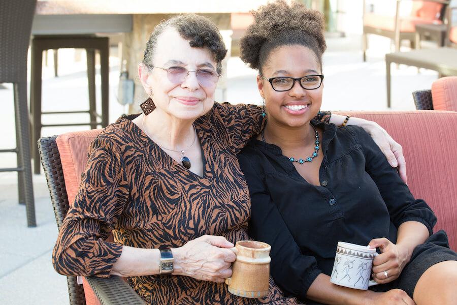 two women enjoying a drink