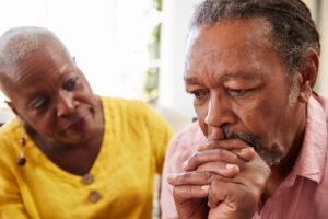 lady consoling older man