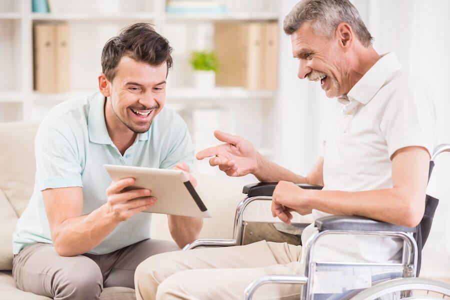 man showing older man tablet