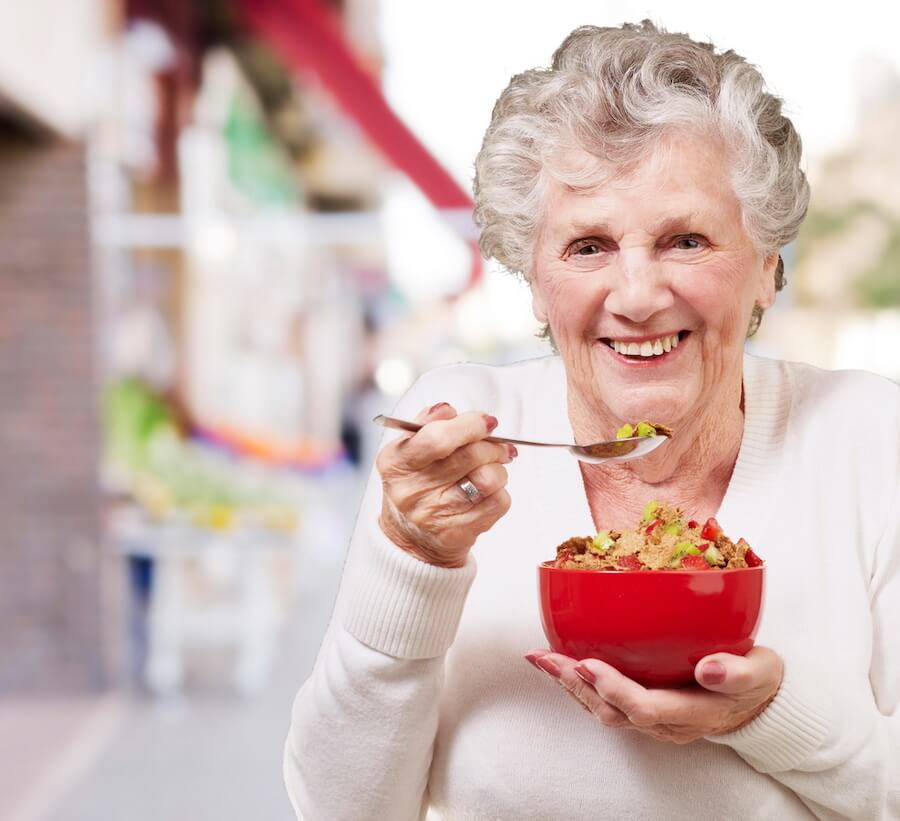 older woman eating cereal